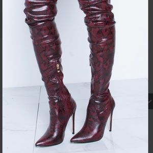 Burgundy snake print boots. Size 6